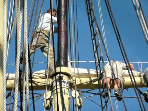 Furling sails aboard the squarerigger Joseph Conrad