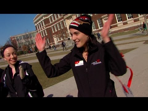 UC tour guide shows campus cheer to visiting high school students and their parents