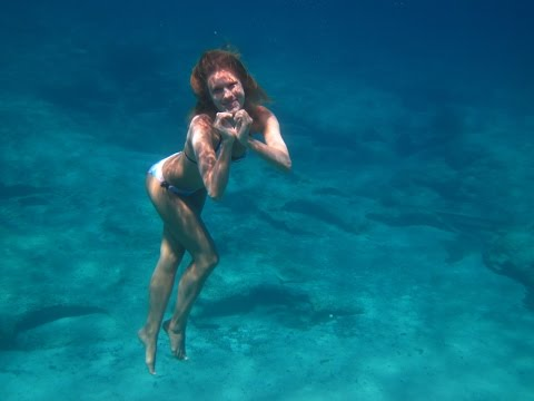 Girl like a mermaid in the sea.Freediving.8 meters of depth.Video by Tanya Tonica.