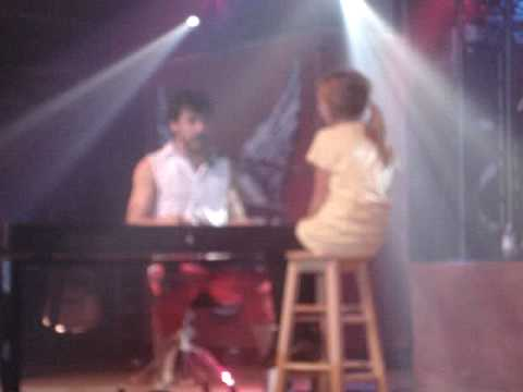 Jake singing For The Nights to a little girl