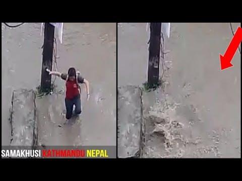 one school girl fall down on road side water flood in kathmandu nepal