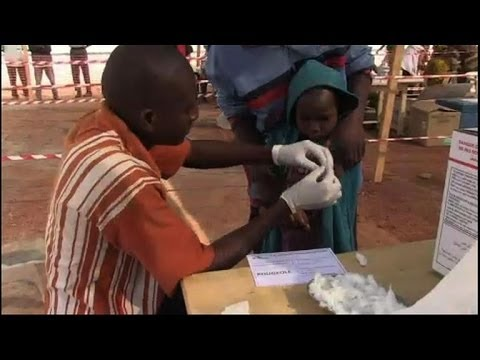 As kids get vaccines, school resumes in Bangui camps