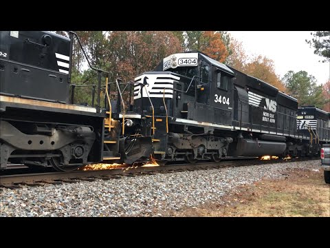 P80 with Extreme Wheel Slip Grinds the Rails While 212 with Interstate Waits to Pass