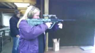 female is shooting STG 77