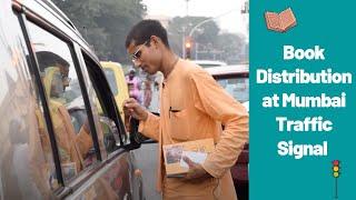 Srila Prabhupada's Book Distribution in Mumbai Traffic signals by an Enthusiastic ISKCON Brahmachari