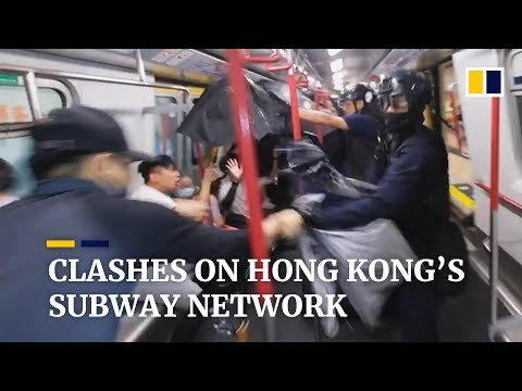 Chaos on Hong Kong's MTR network as police beat people on train