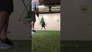 Man Balances on Rope and Catches Golf Ball Shot by Another Person - 1032574