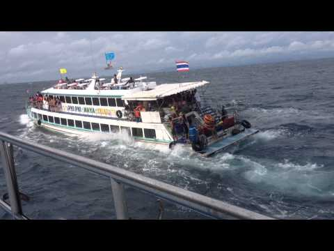 Phi Phi Island ferry full of people and water. (Original Footage)