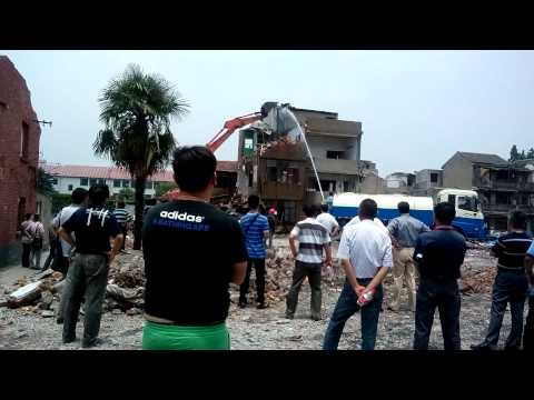 Force to housing demolition in Shanghai, China 2014