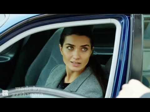 Tuba Buyukustun ( driving her cars )