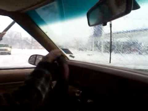 Using a squeeze as windshield wiper - funny ass he