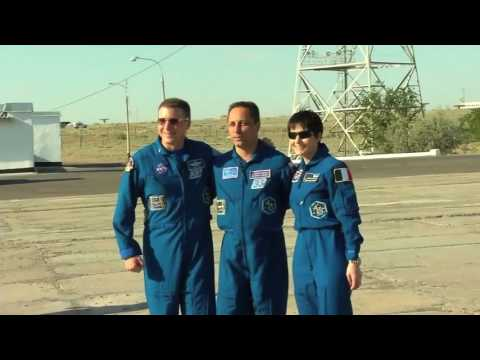 The Expedition 40/41 crew prepares for launch and their Soyuz rocket comes together and moves to pad
