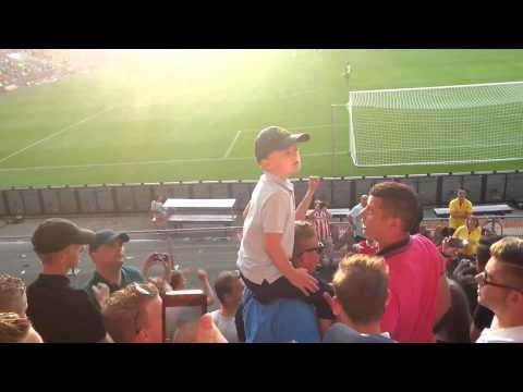 Young Boy Leads other Fans into Football Chant - Eindhoven we love you