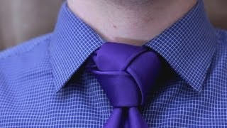Repeat youtube video How to tie a tie - Trinity Knot  (Made Simple)