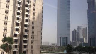 Dubai Train view -  approaching Emirates Tower Station
