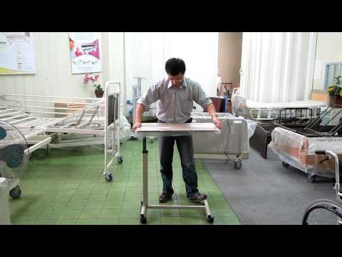 Overbed table use - Chen Kuang