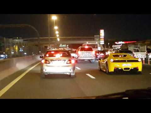 Ferrari in the night traffic on Dubai Airport Street 15.01.2017