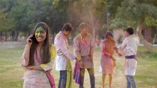 Cute Indian girl wishing relatives 'Happy Holi' on phone call - Festival celebration
