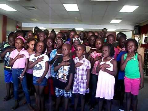 South Sudanese children singing South Sudan National Anthem.AVI