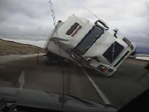 Raw: Big Rig Blows Over, Crushes Patrol Car
