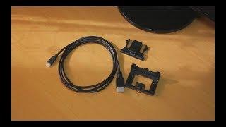Обзор посылки – корпус держатель и кабель HDMI для экшн-камеры.
