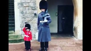 Boy Dressed as British Guard Salutes Windsor Castle Soldiers
