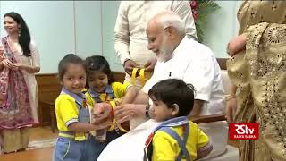 Prime Minister Narendra Modi celebrates Raksha Bandhan with school children