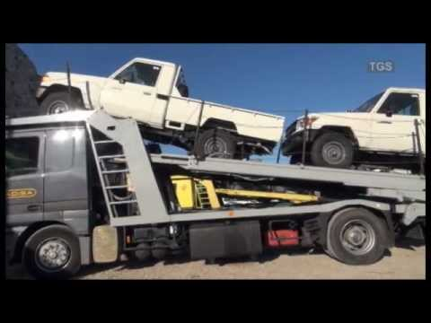 Toyota Land Cruiser 79 Pick-Up unloaded from car carrier
