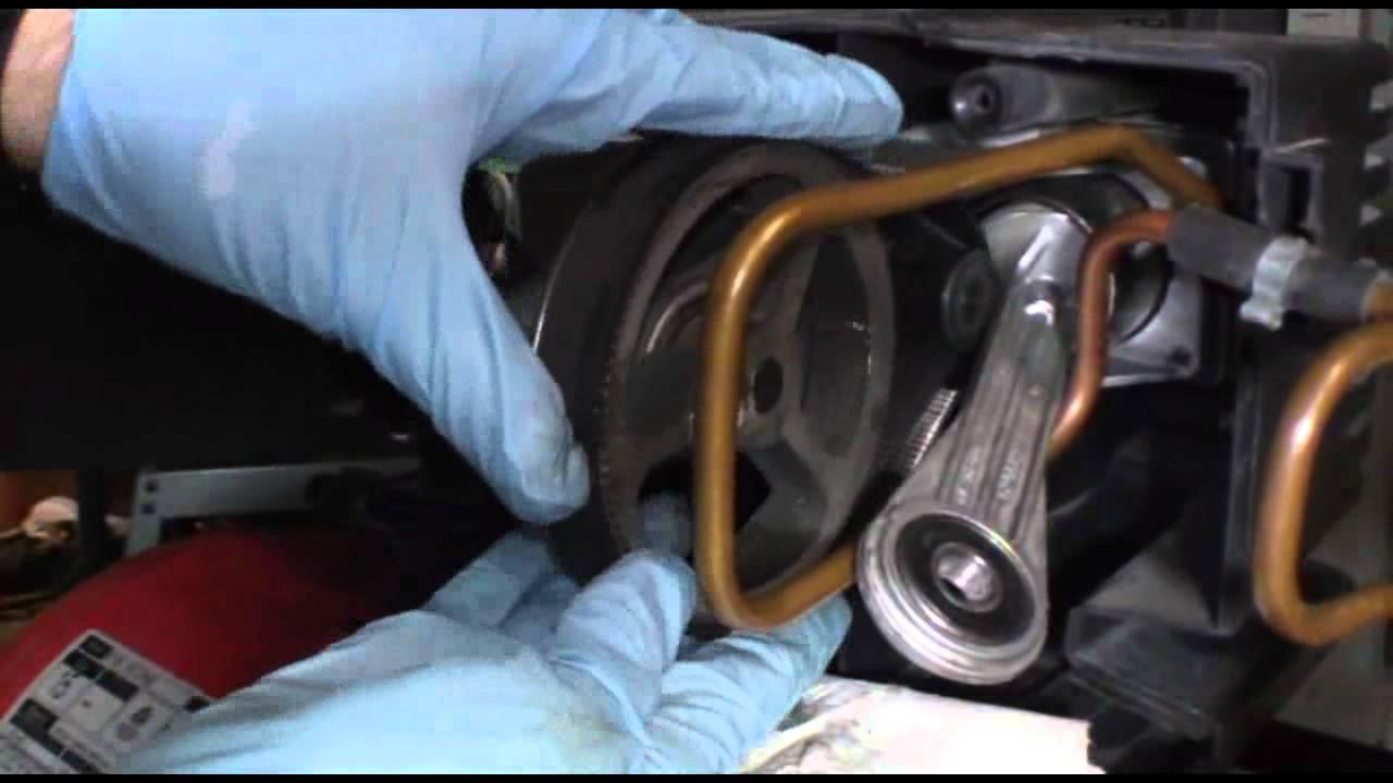 Replacing a broken belt on an air pressor that needs