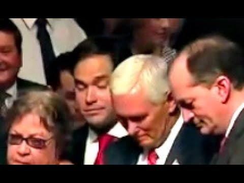 Marco Rubio  tries to get to front with president trump but gets blocked by a lady