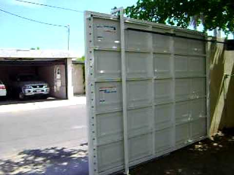 Puerta automatica corrediza de panel motor liftmaster for Puertas corredizas