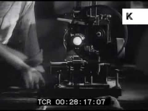 Early Cinema, Projectionist using Hand Crank Film Projector, Cinema Audience