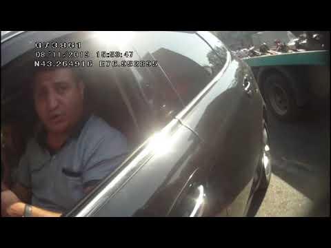 Появилось видео, как полицейского протащили на двери авто в Алматы