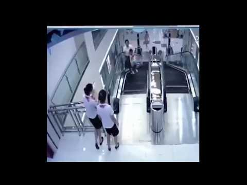 Woman Falls inside Escalator in China