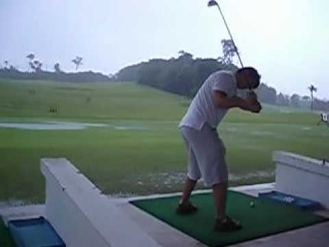 Hitting some golf balls during a torrential downpour in Indonesia