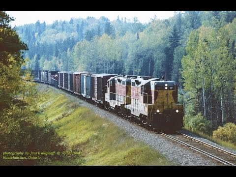 Algoma Central EMD GP7's in the Northwoods on the Oba turn. 9/22/1994...