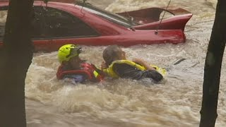Motorist rescued from flooded causeway on Queensland