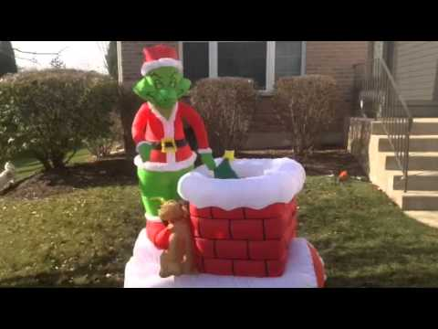 Inflatable Grinch pulling Christmas tree out of chimney - YouTube