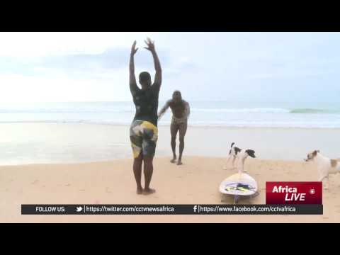 Young Sierra Leonean woman defies tradition, takes up surfing, a male-dominated sport