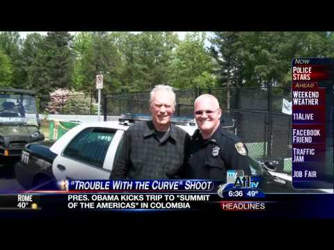 Clint Eastwood helps Dunwoody Police help charity ~ 11Alive News