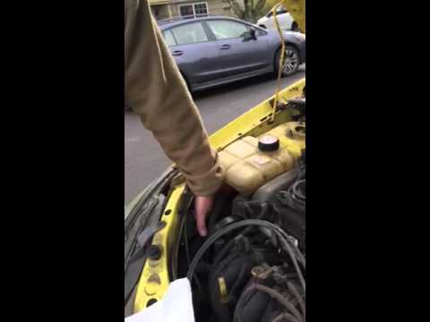 how to change headlight bulb on 2000 ford focus