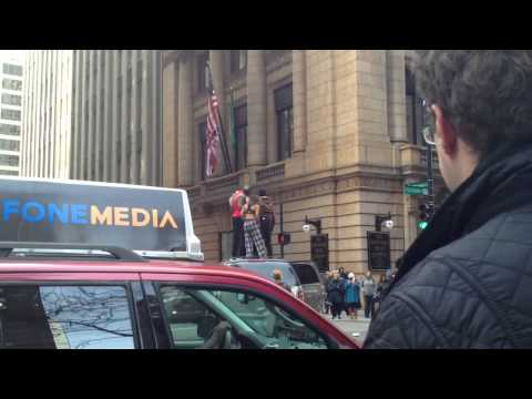 Crazy people block traffic in downtown Chicago Part 1