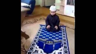 Little Boy saying azan and offering prayer