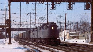 Amtrak GG-1 roars past GG-1 powered freight on the NEC, 2/19/1978