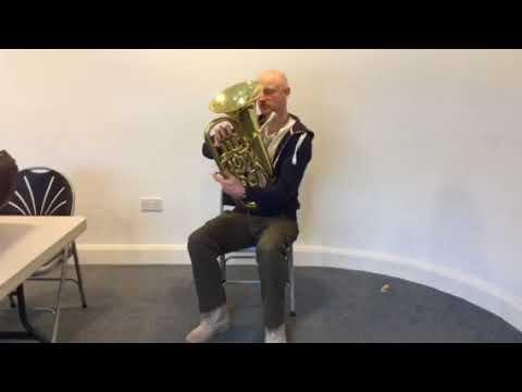 Holding the euphonium and baritone