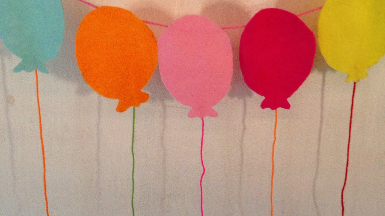 How to make a balloon garland for birthday parties diy for Simple party decorations at home