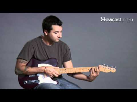 how-to-play-a-d-minor-barre-chord-|-guitar-lessons