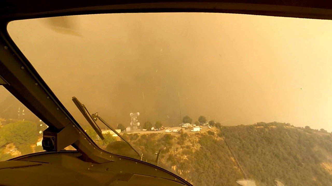 Watch 2 Helicopter Pilots Pull Off A Daring Wildfire Rescue | WIRED