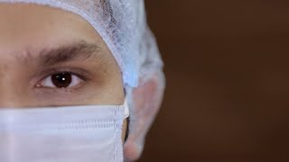 Portrait of a male medical professional wearing a surgical mask and medical cap