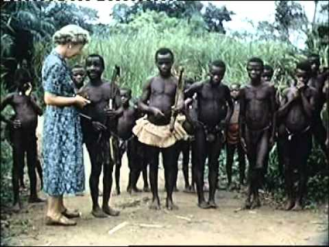 1954, Congo, female tourist buys hunting bow African Pygmies